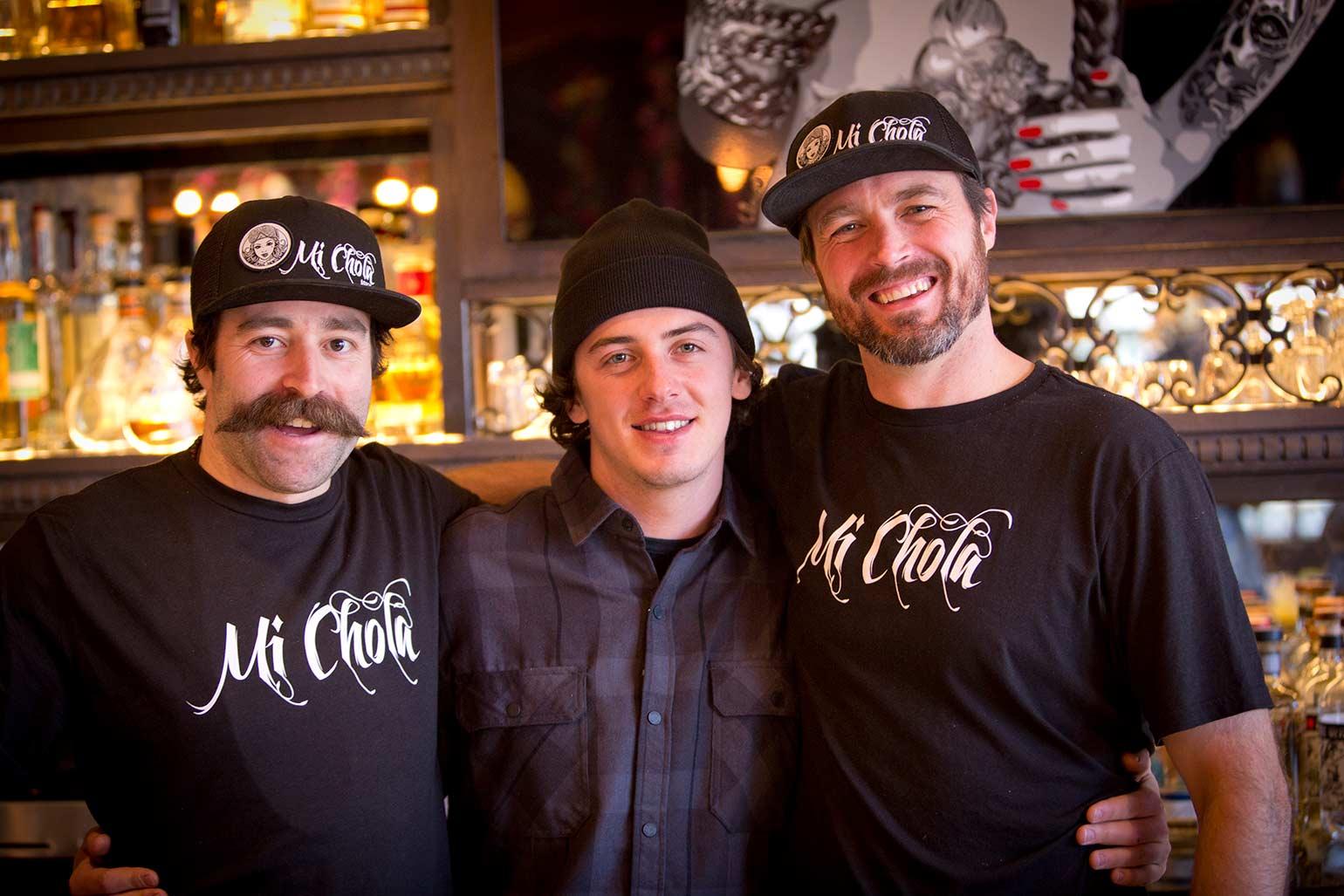 Mark McMorris poses with workers from Mi Chola in Aspen Colorado