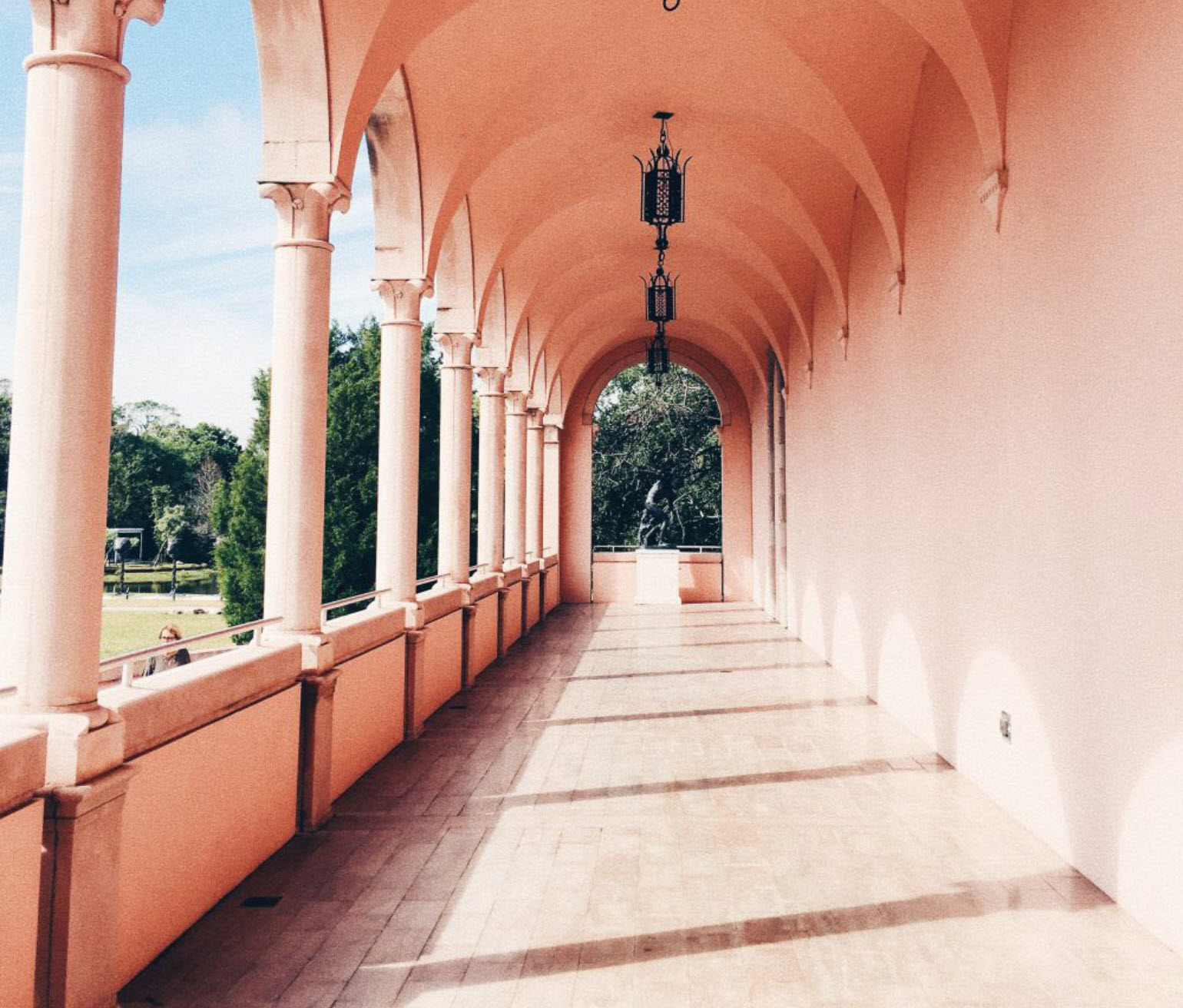 A peach archway located at the Ringling Museum of Art