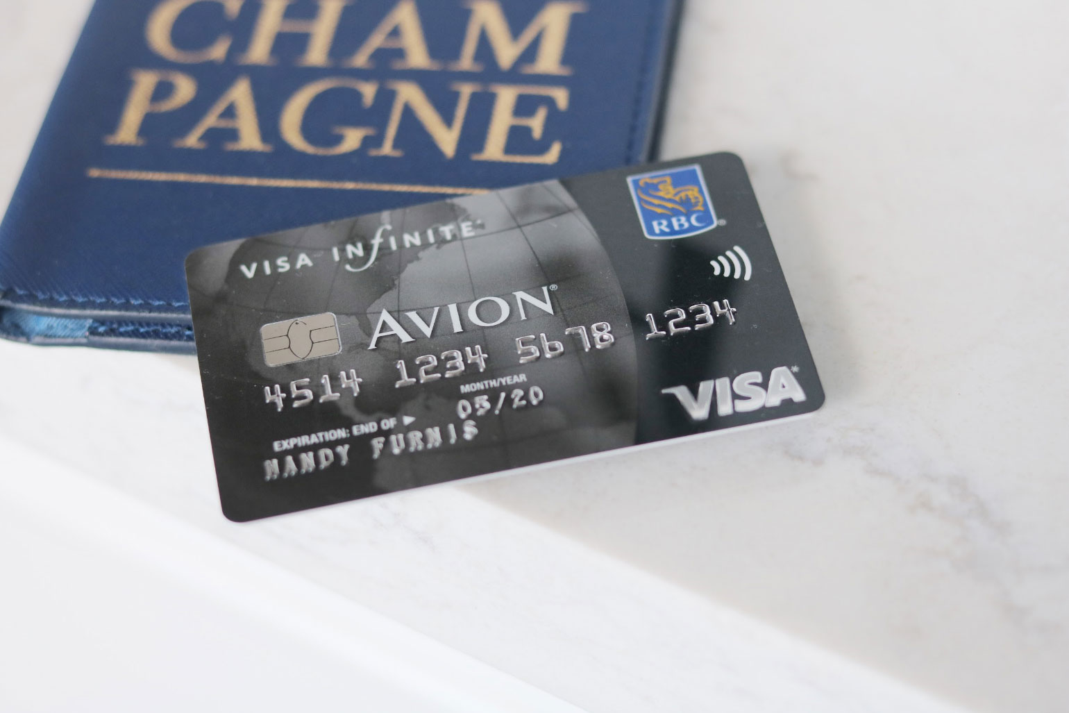 An Avion card with a luggage tag