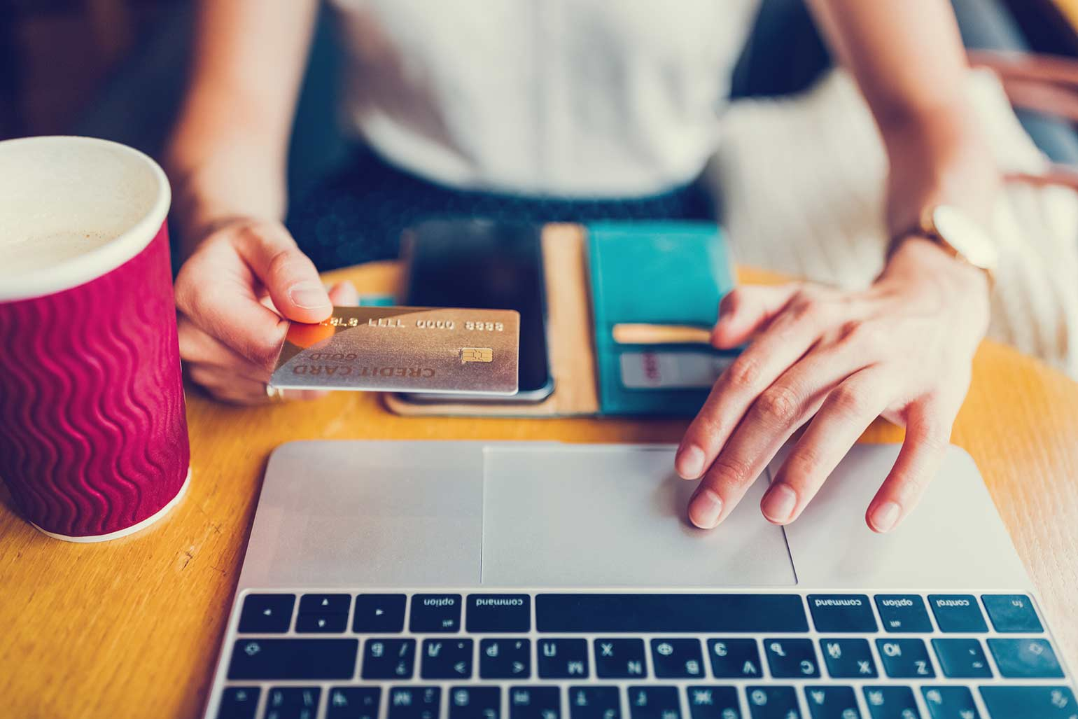 Female hands paying credit card bill on laptop