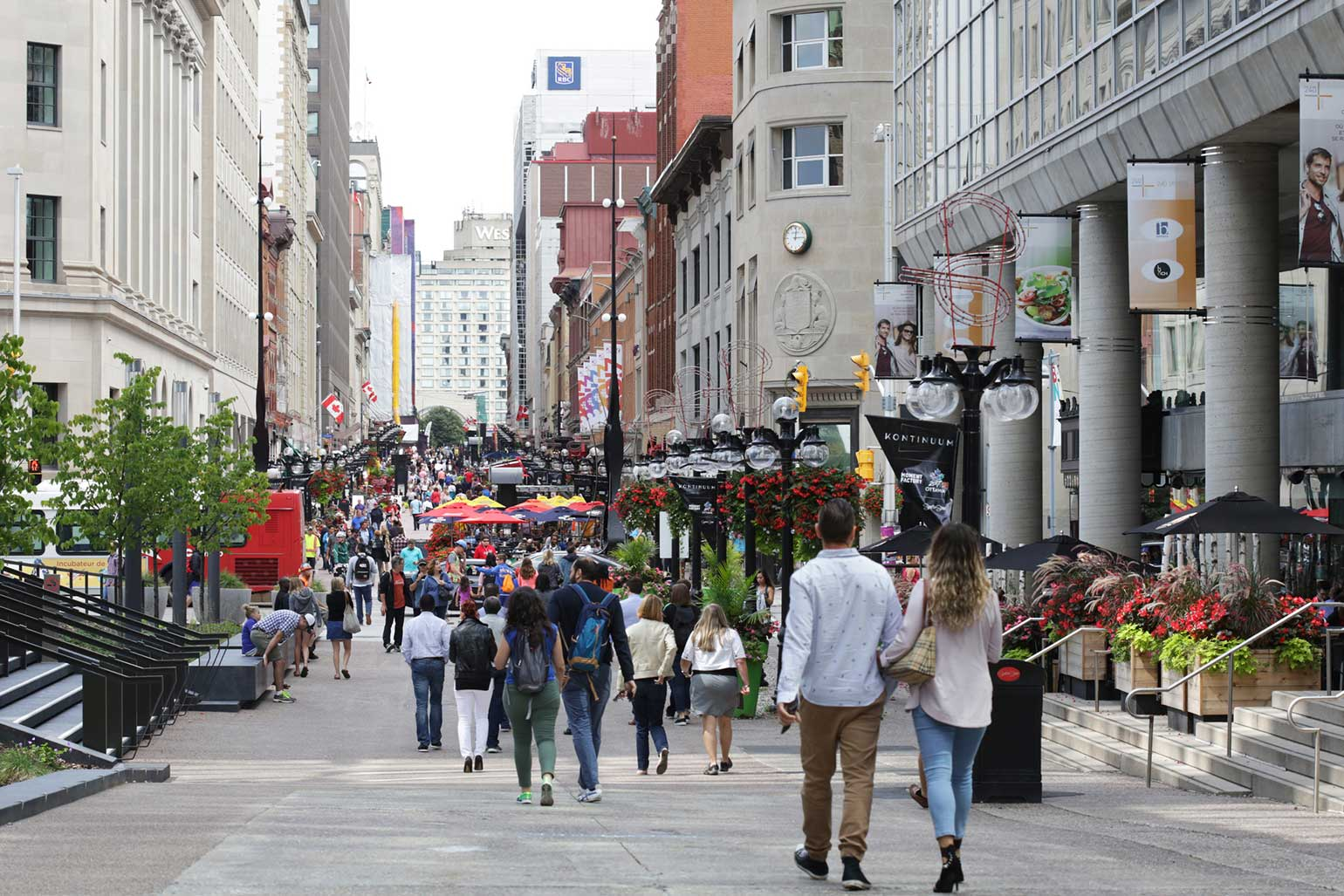 Sparks street mall in Ottawa is filled with visitors admiring the shops and establishments.