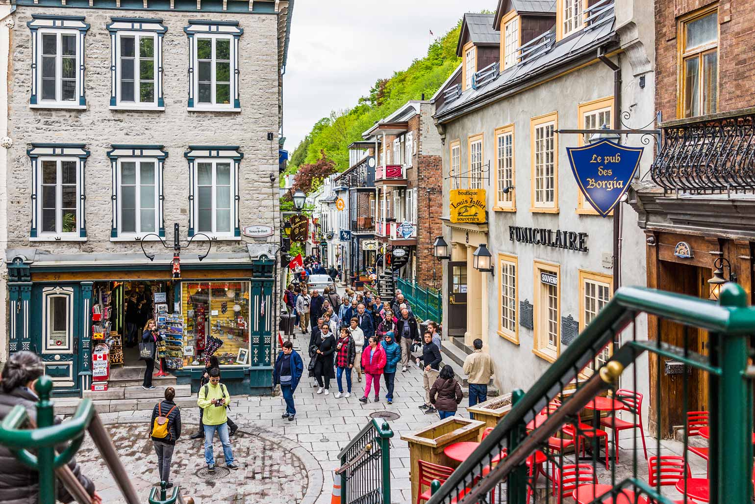 People exploring the stores and restaurants on Rue du Petit Champlain in Quebec City.