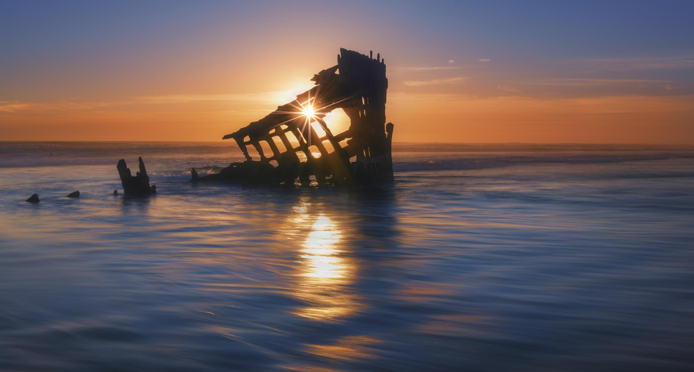 The remains of the Peter Iredale, a four-master ship that ran aground in 1906, at low tide in Fort Stevens State Park.