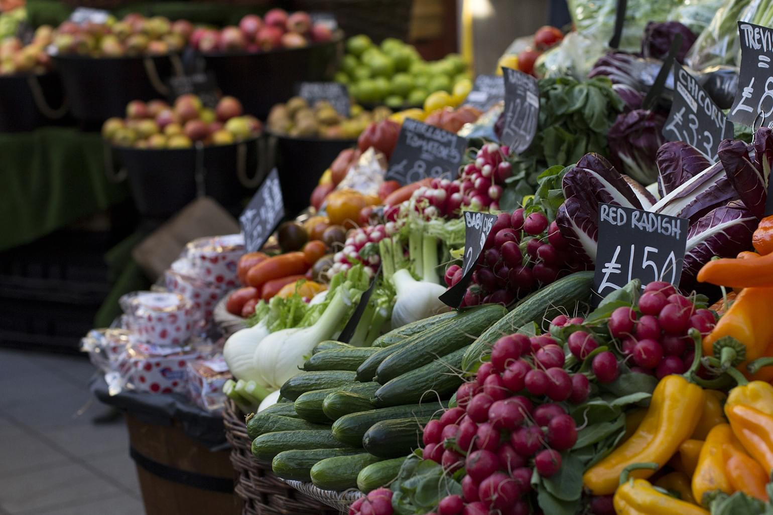 Fruits and vegetables display in a small grocery store.