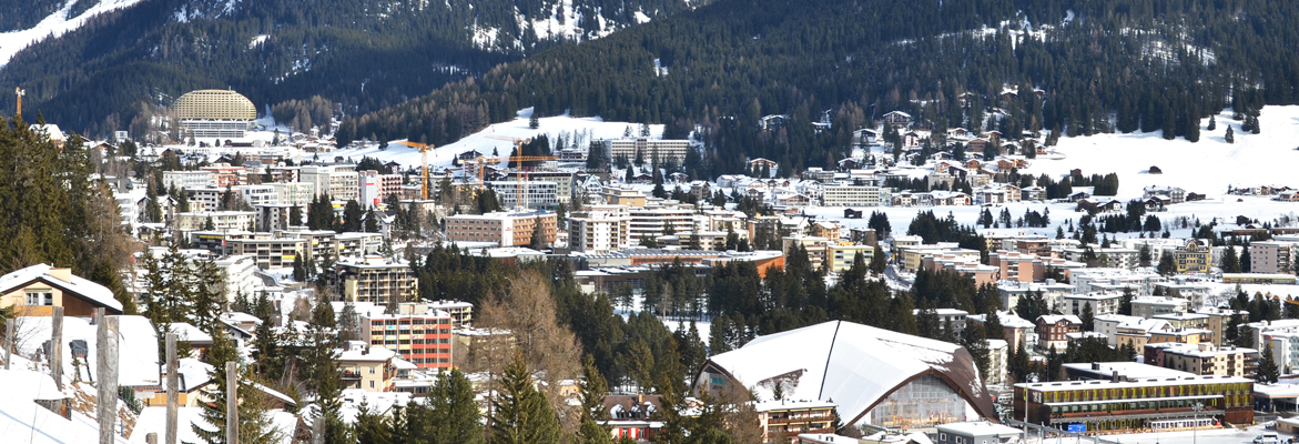 The snow-covered city of Davos at the bottom of the mountain