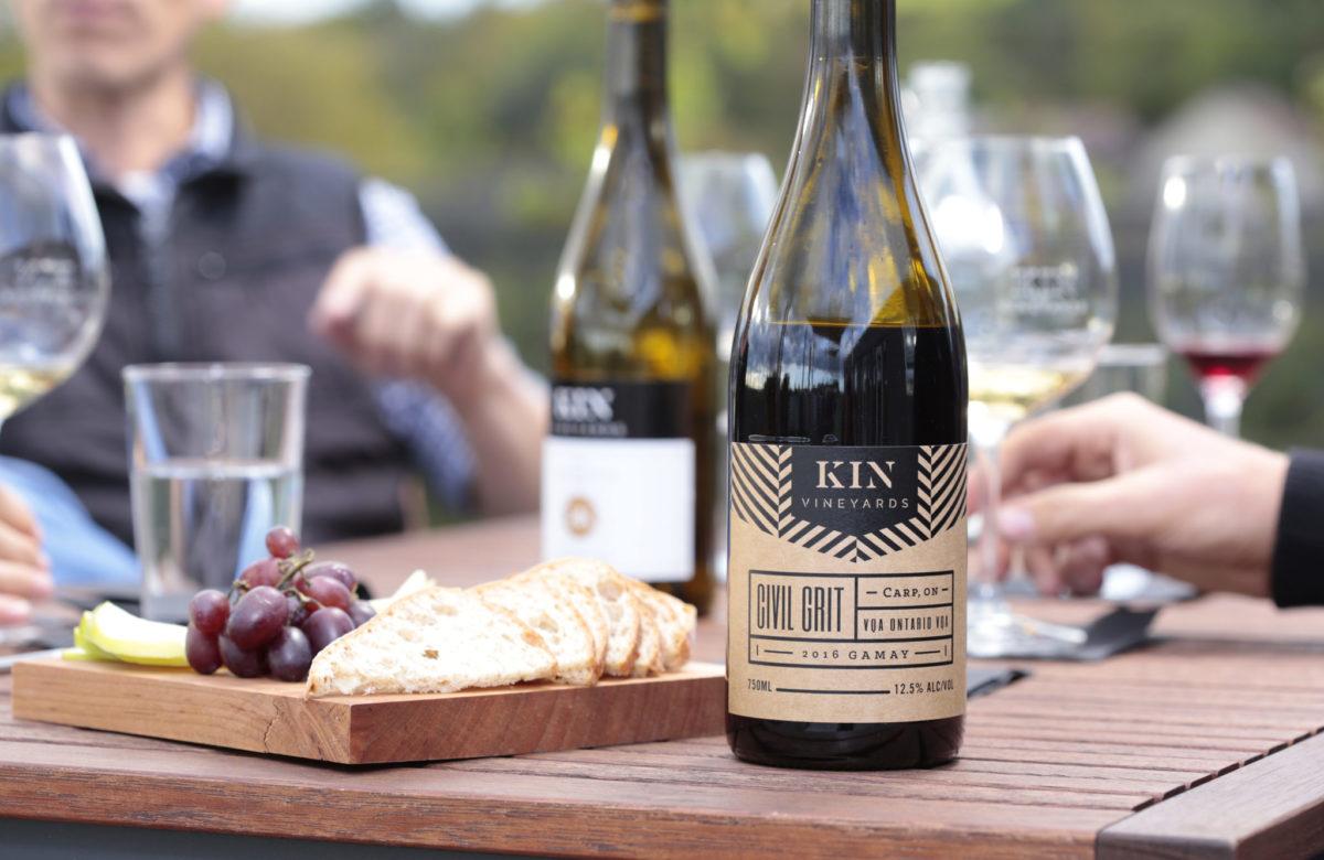 A charcuterie platter beside an unopened bottle of wine at Kin Vineyards in Ottawa