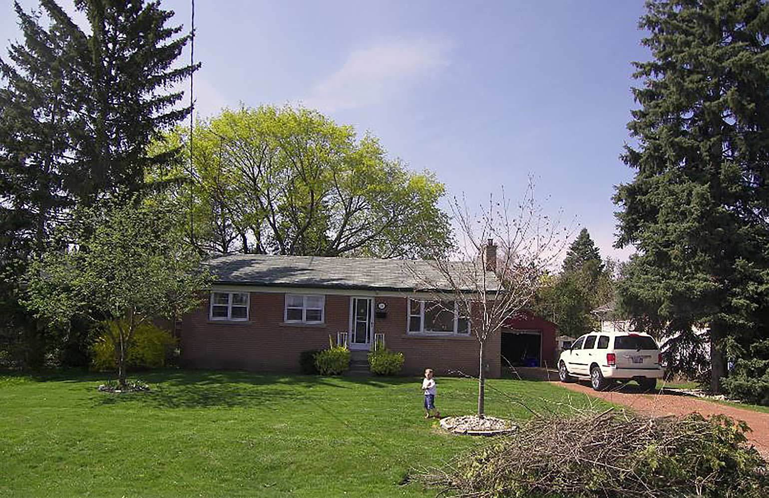Image of Bryan & Sara's first home. A humble, red Brick bungalow.