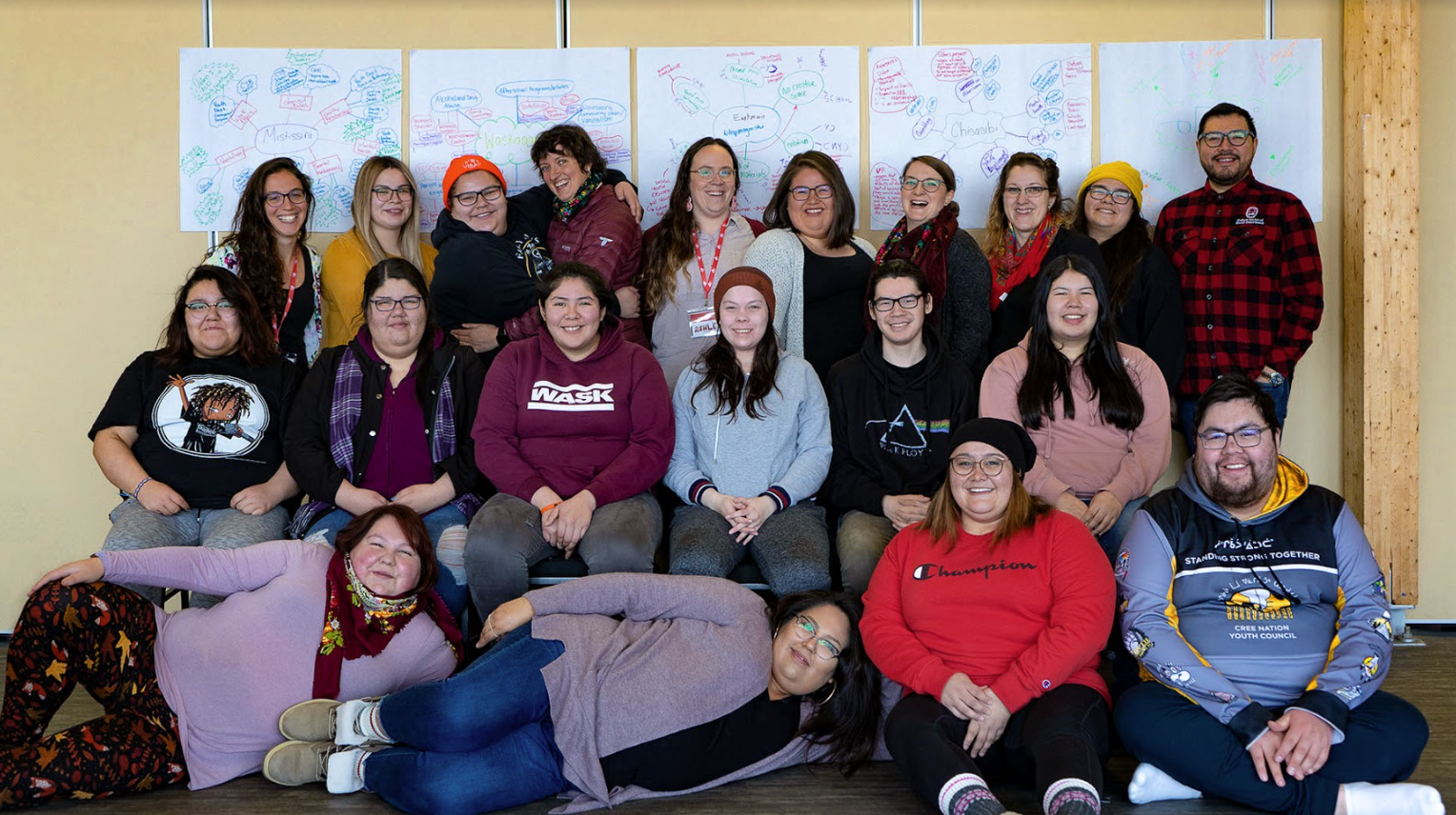 A group of youth representatives and mentors from the Cree Nation Youth Council smiling after a