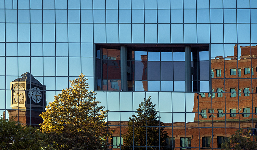 A reflective exterior of an office building in downtown Moncton.