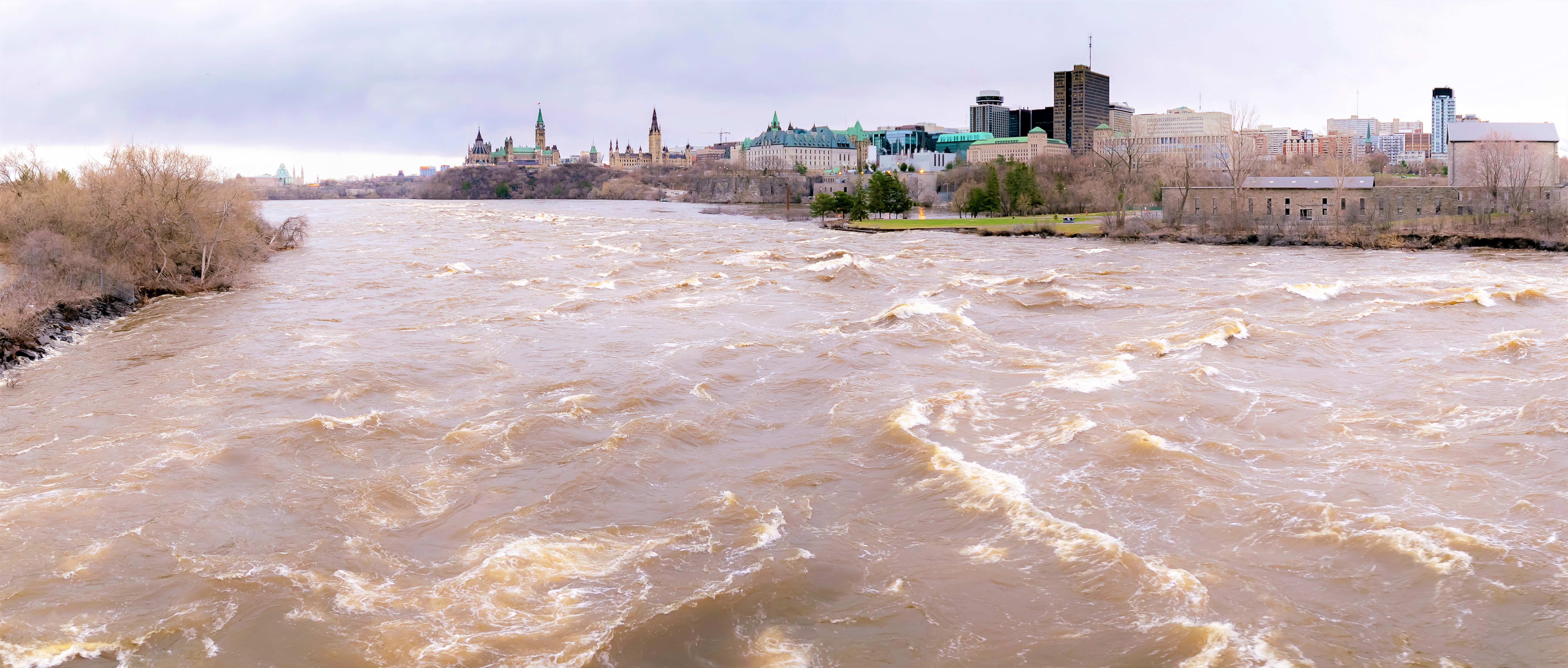 A panoramic view taken from the Portage Bridge in downtown Ottawa, showing flooding of the Ottawa River