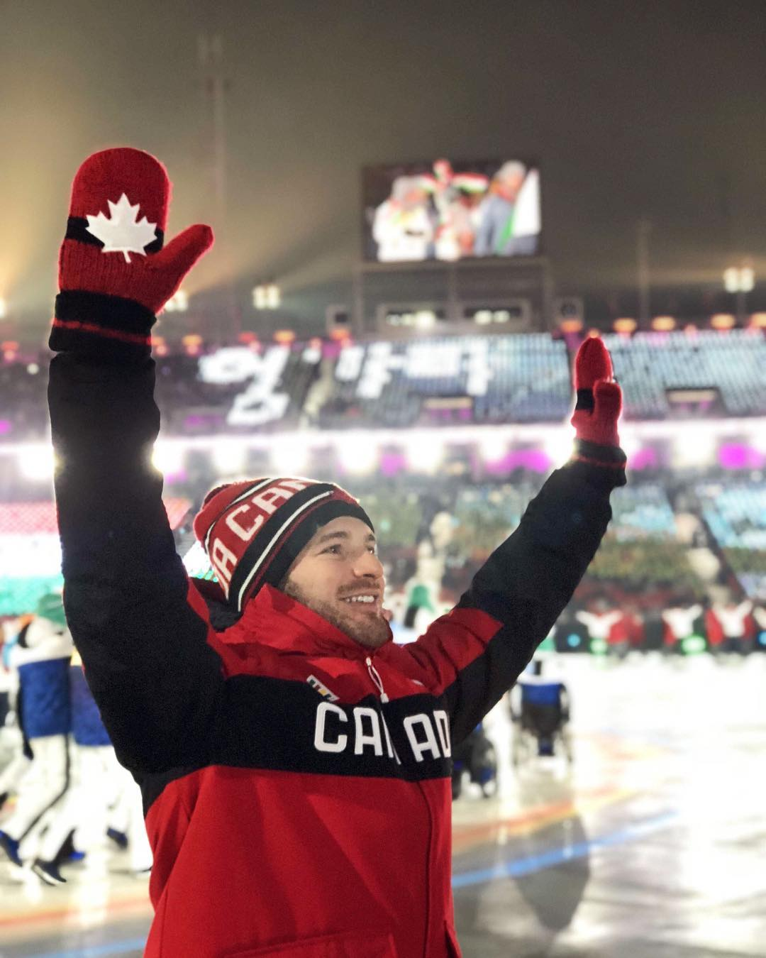 Tyler McGregor waving to fans at the paralympic games.
