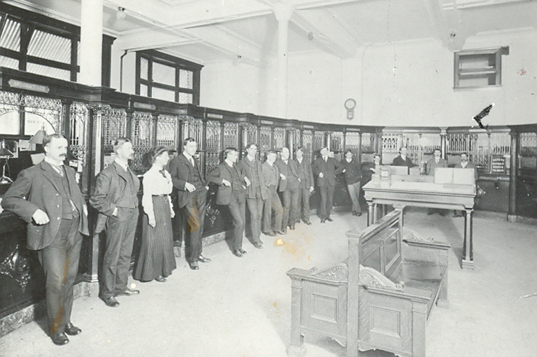 Employees lined up inside RBC Vancouver main branch in 1904