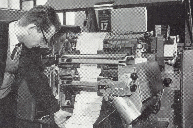 An employee reading a printout from RBCs first computer in 1962.