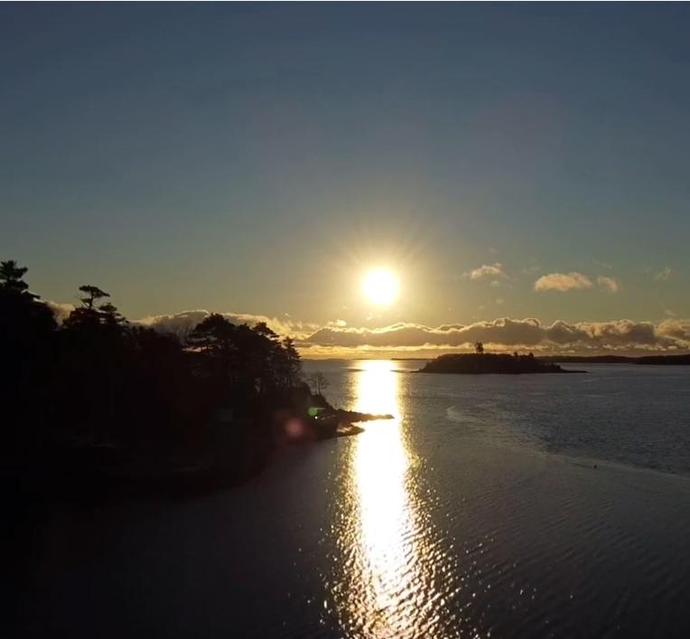 A photograph of the Nova Scotia coast near Lunenburg at sunrise.