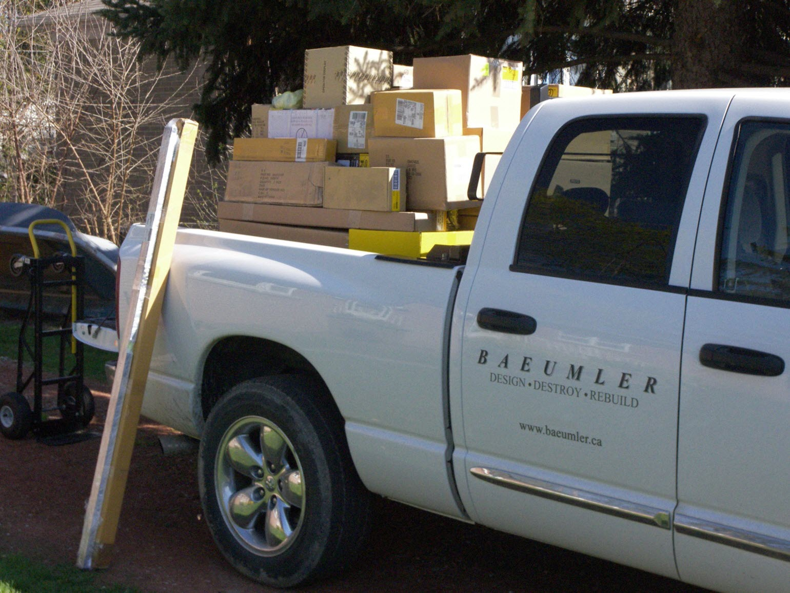 Image of Bryan's white 'Baeumler Construction' pick up