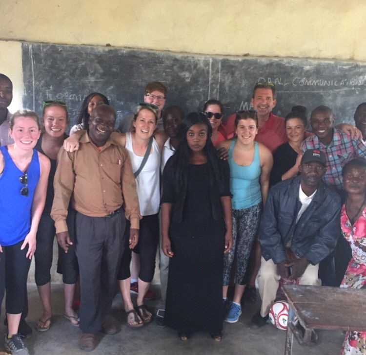 Megan Rizzo with Zambian villagers and Lambton College volunteers posing in a classroom